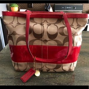 Well loved read and brown Coach purse